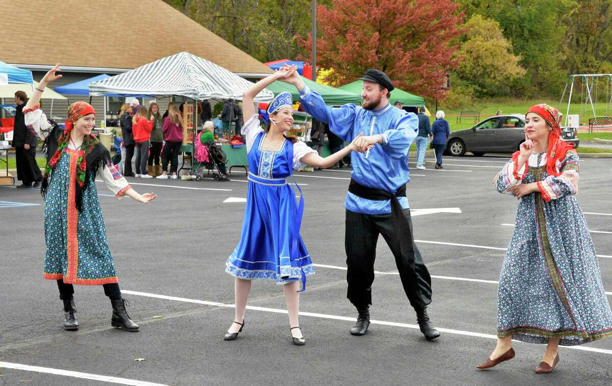 Traditional Russian folk dancers, from left, Masha Brosgol of Albany, Anastasia Welsh of Saratoga Springs, Nikolai Roschko of Slingerlands and Alika Taylor of Troy, during the Taste of Russia Festival at the Nativity of the Most Holy Mother church Saturday Oct. 20, 2018 in Colonie, NY. (John Carl D'Annibale/Times Union)