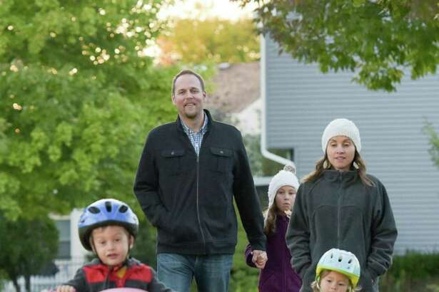 Michael and Sarah Johnson of Carol Stream, Ill., take an after-dinner walk with their children, Titus, 4, Avianna, 8, and Isabelle, 2. The Johnsons are members of a health care sharing ministry.