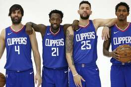 Los Angeles Clippers players, from left, Milos Teodosic, Patrick Beverley, Austin Rivers, and Lou Williams, during the team's media day in Los Angeles on September 25, 2017. (Al Seib/Los Angeles Times/TNS)