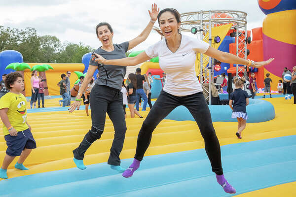 Dozens of San Antonio families hit the Wheatley Heights Sports Complex Saturday, Oct. 20, 2018, when the largest traveling bounce house experience in America came to town.