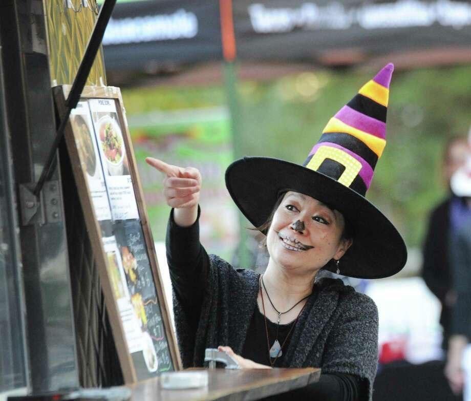 "Yuki Nakamichi dressed as a witch during the ""Trunk or Treat"" Halloween event at the First Congregational Church in Old Greenwich, Conn., Saturday night, Oct. 20, 2018. The event featured the Halloween-themed decorated trunks of cars of the participants in the parking lot of the church. Photo: Bob Luckey Jr. / Hearst Connecticut Media / Greenwich Time"