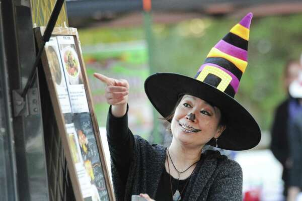 """Yuki Nakamichi dressed as a witch during the """"Trunk or Treat"""" Halloween event at the First Congregational Church in Old Greenwich, Conn., Saturday night, Oct. 20, 2018. The event featured the Halloween-themed decorated trunks of cars of the participants in the parking lot of the church."""