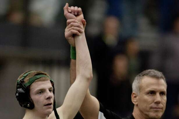 New Milford's Conor Kirkegard is declared the winner during his 113-pound match against Newington's Brian Amato at the 2012 state open finals.