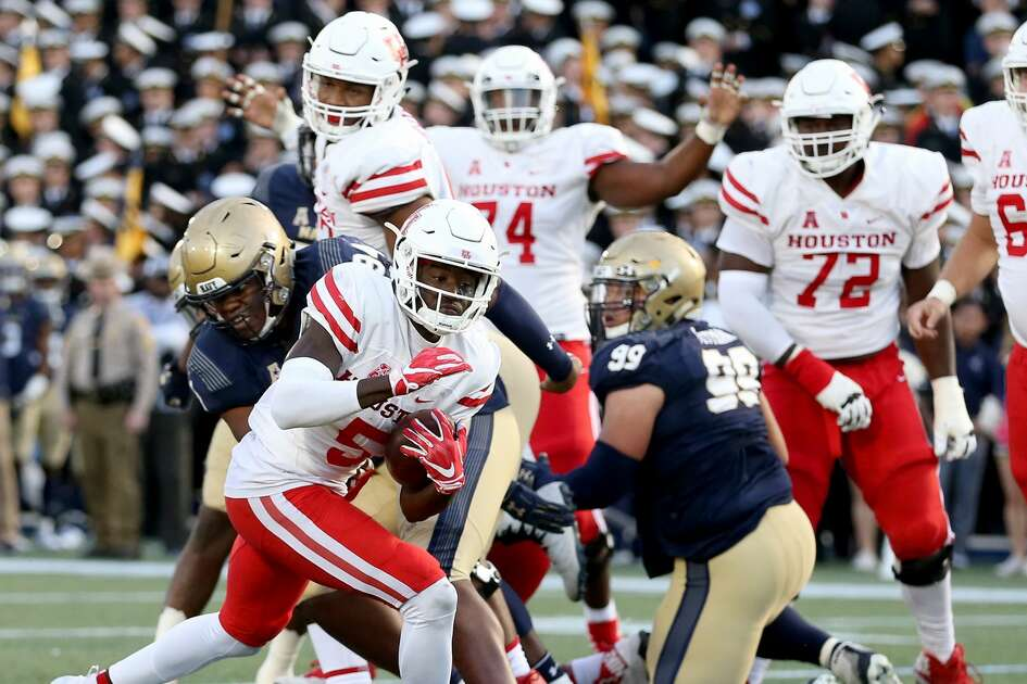 ANNAPOLIS, MD - OCTOBER 20: Marquez Stevenson #5 of the Houston Cougars scores a touchdown against the Navy Midshipmen during the second half at Navy-Marines Memorial Stadium on October 20, 2018 in Annapolis, Maryland. (Photo by Will Newton/Getty Images)