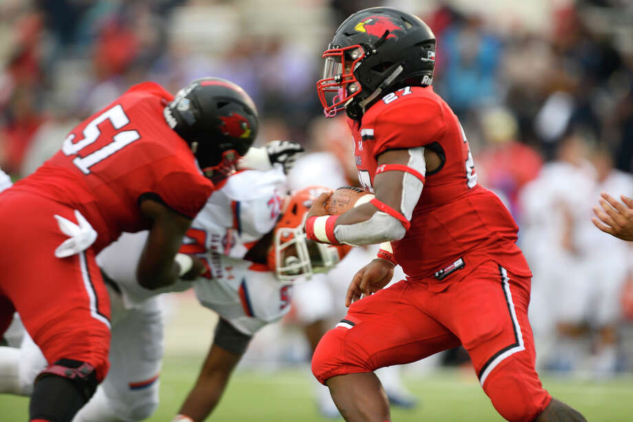 Lamar running back 	A.J. Walker carries against Sam Houston at Provost Umphrey Stadium on Saturday. 