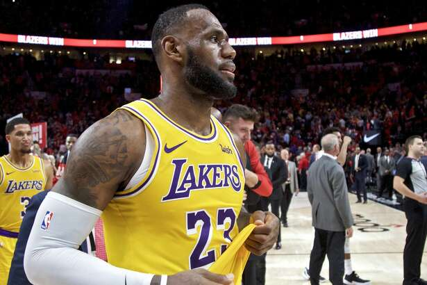 Los Angeles Lakers forward LeBron James walks off the court after an NBA basketball game against the Portland Trail Blazers in Portland, Ore., Thursday, Oct. 18, 2018. The Trail Blazers won 128-119. (AP Photo/Craig Mitchelldyer)
