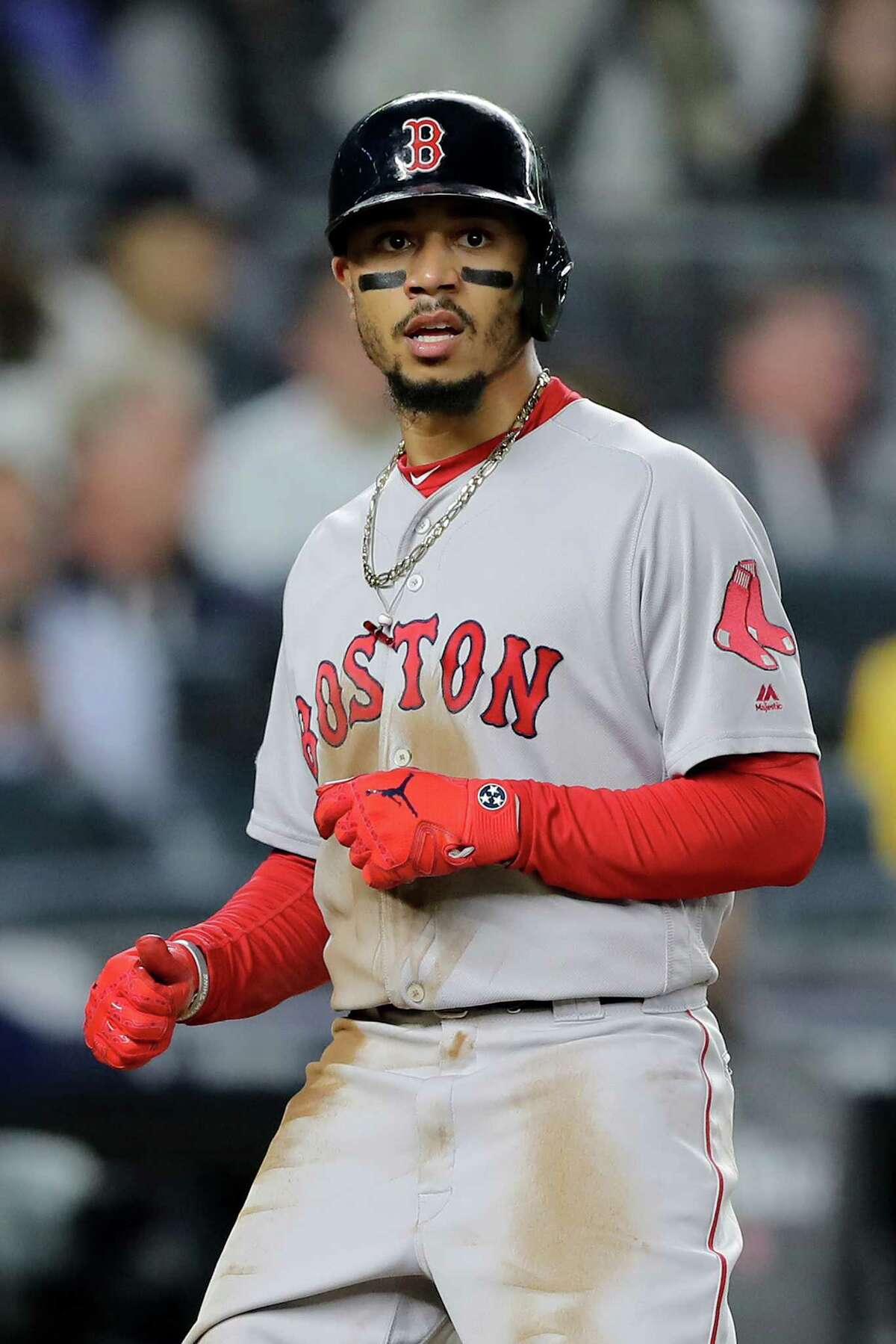 NEW YORK, NEW YORK - OCTOBER 08: Mookie Betts #50 of the Boston Red Sox celebrates after scoring a run off of a sac fly hit by J.D. Martinez #28 against the New York Yankees during the third inning in Game Three of the American League Division Series at Yankee Stadium on October 08, 2018 in the Bronx borough of New York City. (Photo by Elsa/Getty Images)