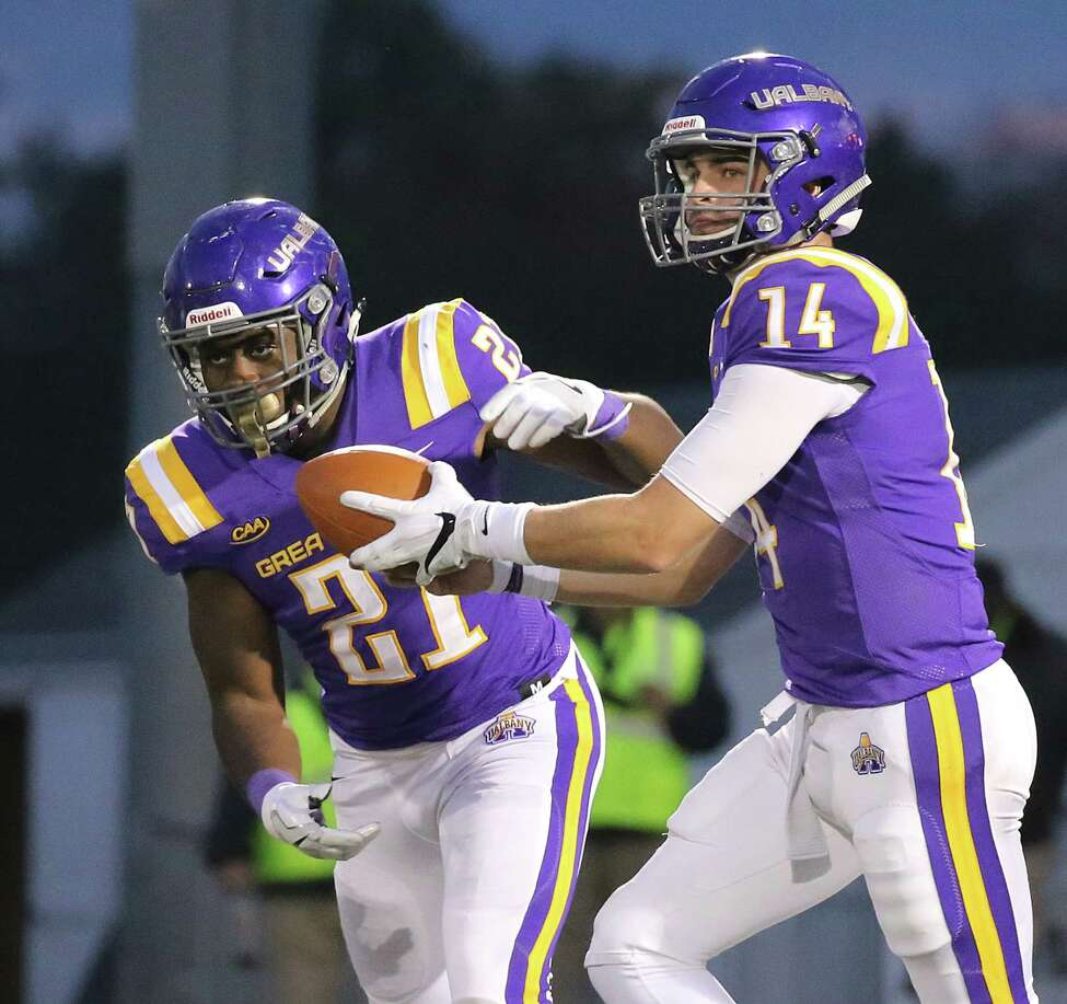 UAlbany quarterback Vince Testaverde hands off to Karl Mofor during the Danes' 56-28 loss to Towson on Saturday, Oct. 20, 2018. (Thomas Palmer / Times Union)