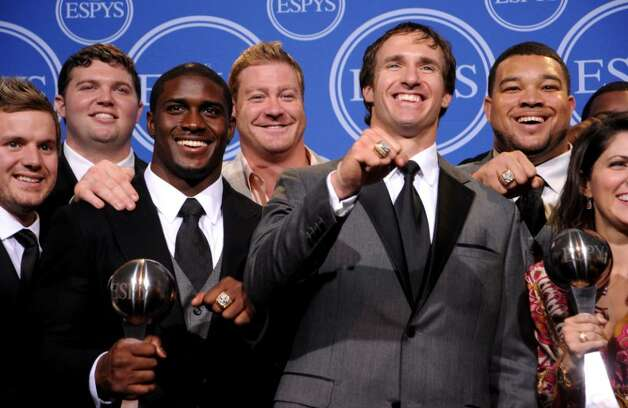 LOS ANGELES, CA - JULY 14:  (2nd L) Reggie Bush, (C) Drew Brees pose along with members of the New Orleans Saints after winning the ESPY for Best Team during the 2010 ESPY Awards at Nokia Theatre L.A. Live on July 14, 2010 in Los Angeles, California.  (Photo by Jason Merritt/Getty Images) *** Local Caption *** Reggie Bush;Sean Payton;Jeremy Shockey Photo: Jason Merritt, Getty Images / 2010 Getty Images