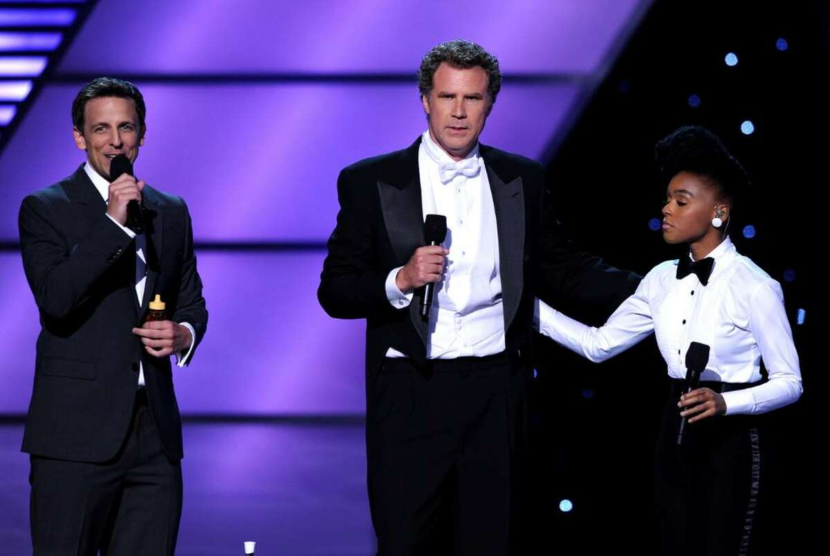 LOS ANGELES, CA - JULY 14: (L-R) Host Seth Meyers, actor Will Ferrell and Janelle Monae onstage during the 2010 ESPY Awards at Nokia Theatre L.A. Live on July 14, 2010 in Los Angeles, California. (Photo by Kevin Winter/Getty Images) *** Local Caption *** Seth Meyers;Will Ferrell;Janelle Monae