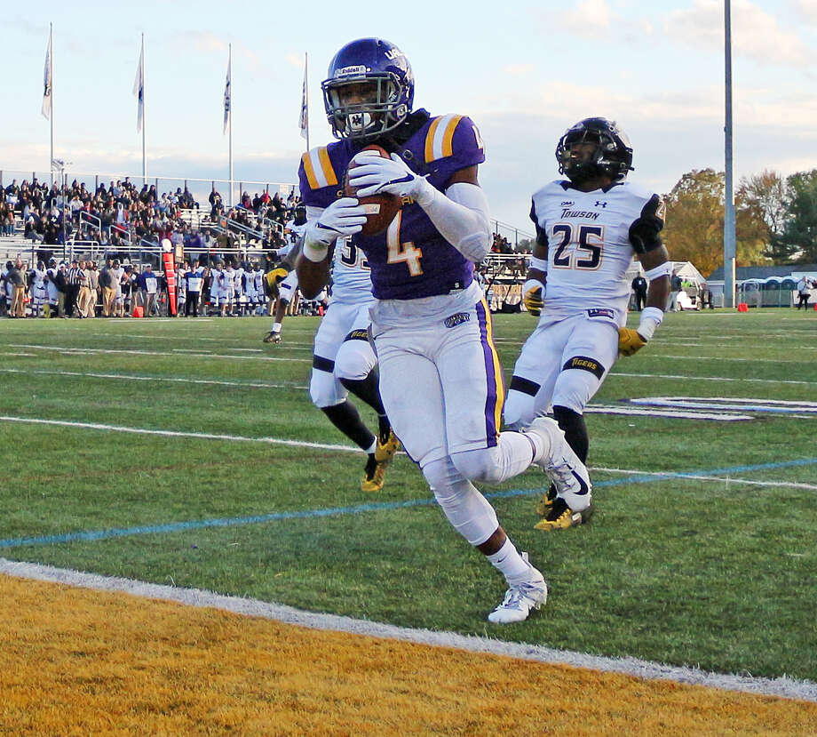 UAlbany's Juwan Green scores on a 60-yard touchdown pass on homecoming day at Casey Stadium during the Danes' game against Towson on Saturday, Oct. 20, 2018. (Thomas Palmer / Times Union)