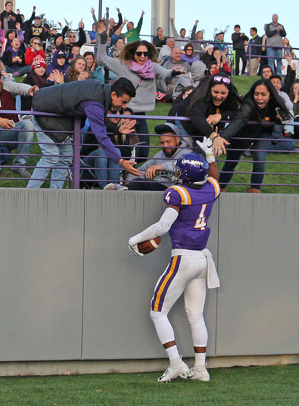 UAlbany receiver Juwan Green celebrates with fans after his first-quarter touchdown in the Danes game against Towson on Saturday, Oct. 20, 2018. (Thomas Palmer / Times Union)