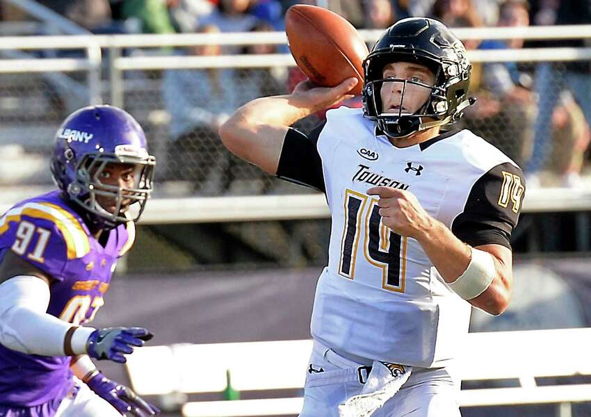 Towson quarterback #14 Tom Flacco gets off a pass as UAlbany's #91 Anthony Lang closes in during Saturday's Colonial Athletic Association game Oct. 20, 2018 in Albany, NY. (John Carl D'Annibale/Times Union)