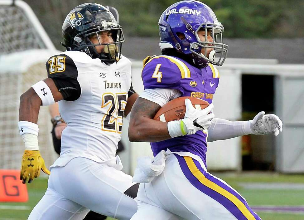 UAlbany's #4 Juwan Green outruns Towson's #25 Terrill Gillette to score a touchdown during a Colonial Athletic Association game Saturday Oct. 20, 2018 in Albany, NY. (John Carl D'Annibale/Times Union)