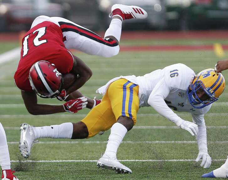 Phillip Baptiste, left, has overcome a lot of hurdles in life, so being upended by a tackler isn't a big deal.