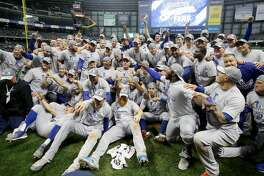 MILWAUKEE, WI - OCTOBER 20: The Los Angeles Dodgers celebrate after defeating the Milwaukee Brewers in Game Seven to win the National League Championship Series at Miller Park on October 20, 2018 in Milwaukee, Wisconsin. (Photo by Jonathan Daniel/Getty Images)