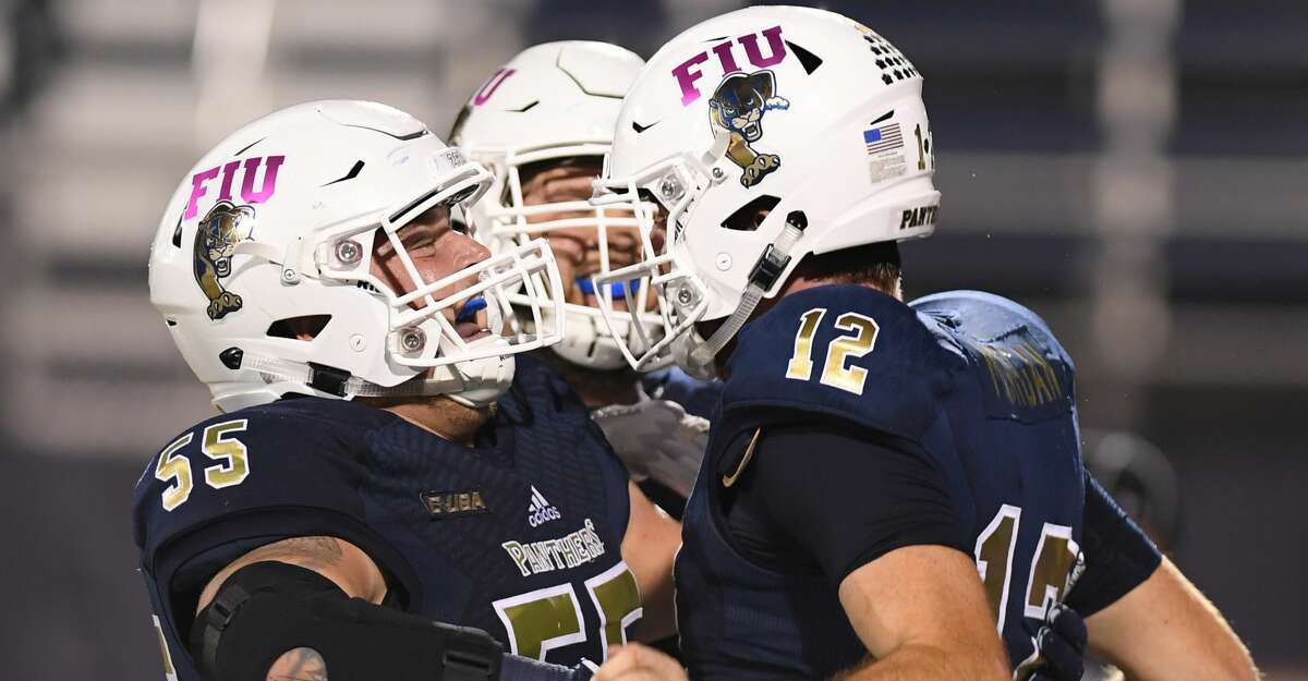 MIAMI, FL - OCTOBER 20: James Morgan #12 celebrates a touchdown with Shane McGough #55 of the FIU Golden Panthers in the second half against the Rice Owls at Ricardo Silva Stadium on October 20, 2018 in Miami, Florida. (Photo by Mark Brown/Getty Images)