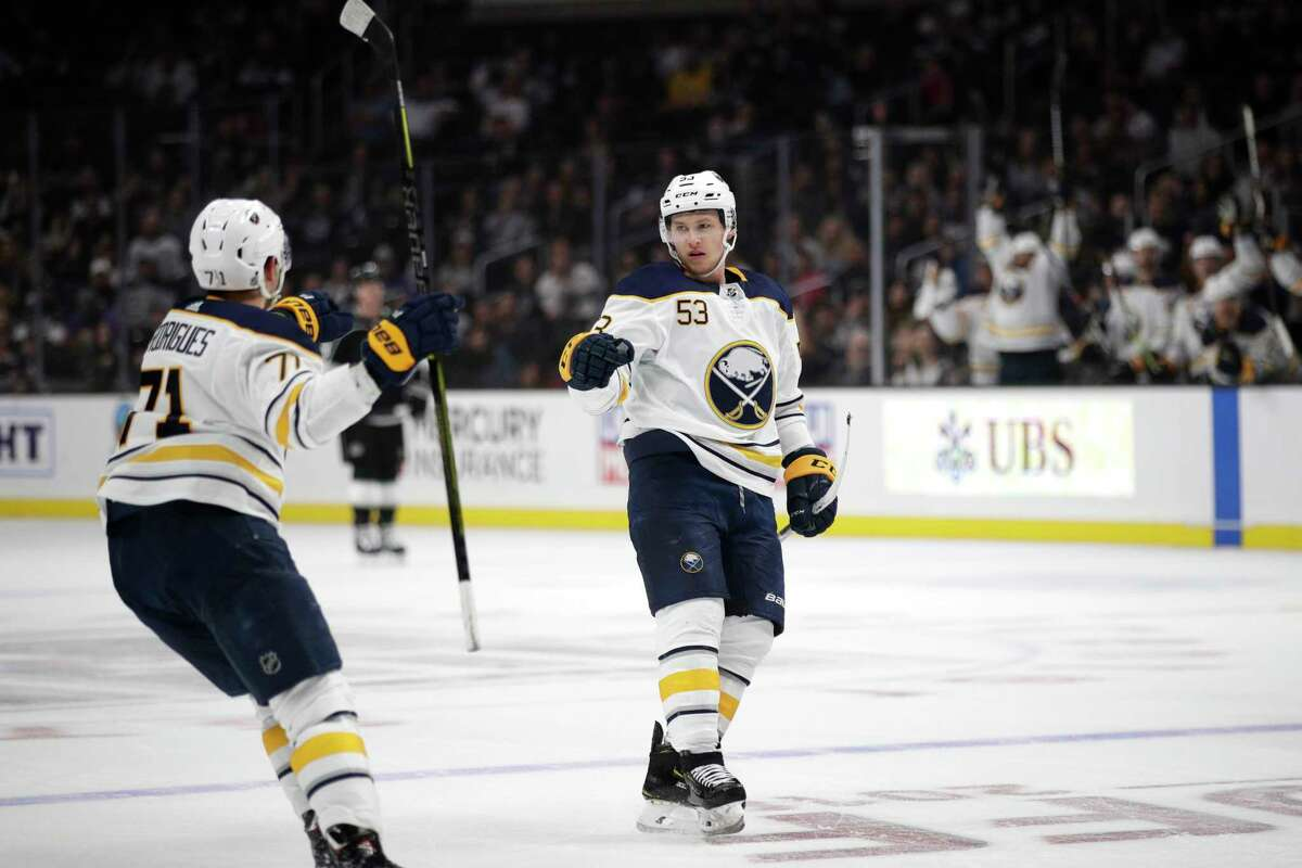 Buffalo Sabres' Jeff Skinner, center, celebrates his empty-net goal with Evan Rodrigues during the third period of an NHL hockey game against the Los Angeles Kings Saturday, Oct. 20, 2018, in Los Angeles. The Sabres won 5-1. (AP Photo/Jae C. Hong)