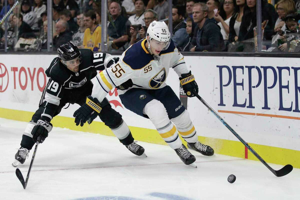 Buffalo Sabres' Rasmus Ristolainen, right, of Finland, is pressured by Los Angeles Kings' Alex Iafallo during the second period of an NHL hockey game Saturday, Oct. 20, 2018, in Los Angeles. (AP Photo/Jae C. Hong)