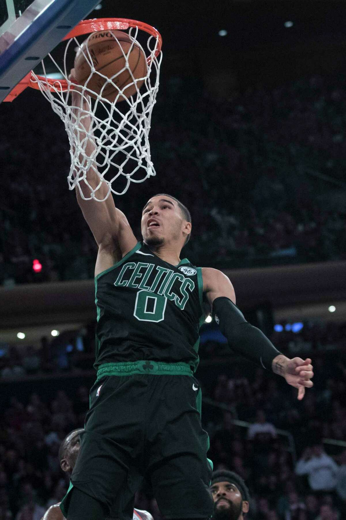 Boston Celtics forward Jayson Tatum dunks during the second half of an NBA basketball game against the New York Knicks, Saturday, Oct. 20, 2018, at Madison Square Garden in New York. (AP Photo/Mary Altaffer)