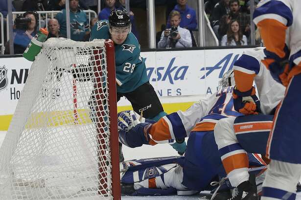 San Jose Sharks right wing Timo Meier (28), from Switzerland, scores a goal past New York Islanders goaltender Robin Lehner, from Sweden, bottom, during the first period of an NHL hockey game in San Jose, Calif., Saturday, Oct. 20, 2018. (AP Photo/Jeff Chiu)