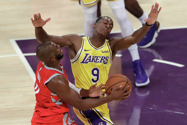 Los Angeles Lakers' Rajon Rondo (9) defends on Houston Rockets' Chris Paul during the first half of an NBA basketball game Saturday, Oct. 20, 2018, in Los Angeles. (AP Photo/Marcio Jose Sanchez)