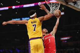 LOS ANGELES, CA - OCTOBER 20: Michael Carter-Williams #1 of the Houston Rockets drives to the basket against JaVale McGee #7 of the Los Angeles Lakers during the first quarter at Staples Center on October 20, 2018 in Los Angeles, California. (Photo by Harry How/Getty Images)