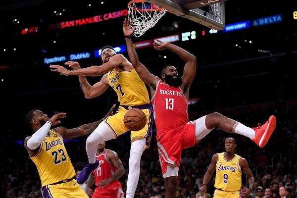 LOS ANGELES, CA - OCTOBER 20: James Harden #13 of the Houston Rockets reacts to his dunk over JaVale McGee #7 of the Los Angeles Lakers during the second quarter at Staples Center on October 20, 2018 in Los Angeles, California. (Photo by Harry How/Getty Images)