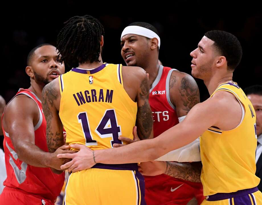 Carmelo Anthony #7 and Eric Gordon #10 of the Houston Rockets restrain Brandon Ingram #14 of the Los Angeles Lakers with the help of Lonzo Ball #2 during a 124-115 Rockets win at Staples Center on October 20, 2018 in Los Angeles, California.  (Photo by Harry How/Getty Images) Photo: Harry How/Getty Images