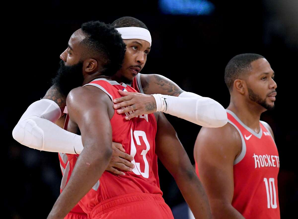 LOS ANGELES, CA - OCTOBER 20: Carmelo Anthony #7, James Harden #13 and Eric Gordon #10 of the Houston Rockets celebrate a 124-115 victory over the Los Angeles Lakers at Staples Center on October 20, 2018 in Los Angeles, California. (Photo by Harry How/Getty Images)