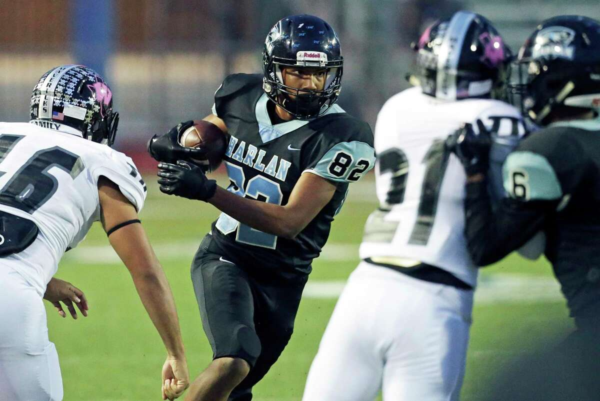 Harlan receiver Shomari Anderson looks for running room after a catch in the first half as Harlan hosts Eagle Pass Winn at Farris Stadium on October 20, 2018.