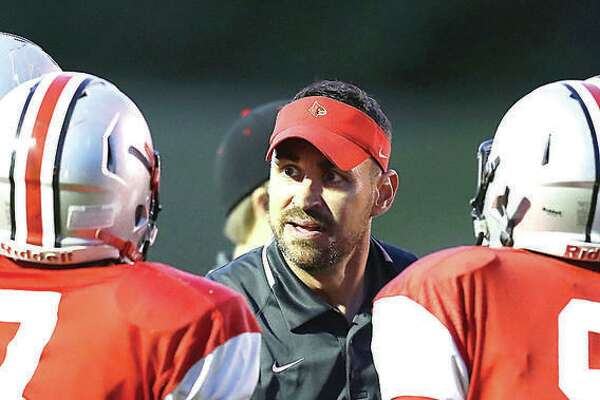 Alton coach Eric Dickerson's Redbirds (5-4) will play their first-round Class 7A playoff game at Rolling Meadows (9-0).