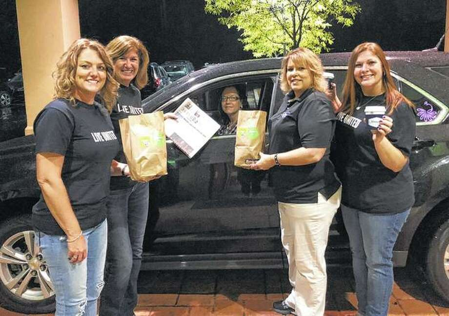 Hampton Inn sponsored a drive-through breakfast Oct. 10 to benefit Prairieland United Way. United Way 2018 campaign co-chairs Lisa Musch (left) and Brittany Henry (right), United Way Executive Director Karen Walker (second from left) and Hampton Inn Manager Michelle Foreman (second from right) were on hand to feed the morning's first customer. The effort raised more than $1,500, with 100 percent of the proceeds going to Prairieland United Way's fundraising campaign. Photo: Photo Provided