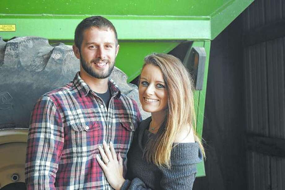 Devin Bergschneider and Lindsay Welsh became engaged Thursday after Bergschneider took her up in an airplane to view the question Marry me? written in a soybean field. Photo: Samantha McDaniel-Ogletree | Journal-Courier