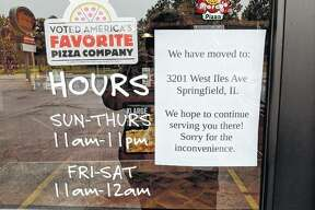 A note on the door at Jacksonville's Marco's Pizza indicates the store has closed.