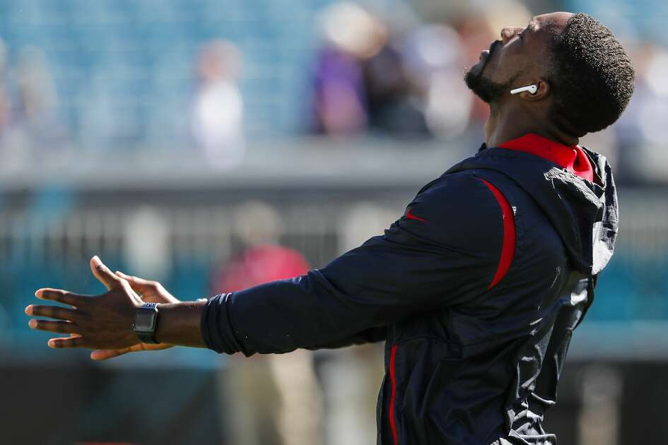 Houston Texans defensive back Andre Hal stretches before an NFL football game against the Jacksonville Jaguars at TIAA Bank Field on Sunday, Oct. 21, 2018, in Jacksonville. Hal was reactivated to the Texans roster after returning to team from cancer treatment.