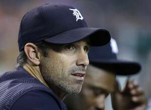 DETROIT, MI - SEPTEMBER 22:  Manager Brad Ausmus #7 of the Detroit Tigers smiles watches from the dugout during the third inning of a game against the Minnesota Twins at Comerica Park on September 22, 2017 in Detroit, Michigan. Manager Al Avila said before the game Friday that Brad Ausmus would not return as the Tigers manager. Ausmus will finish the season as manager. (Photo by Duane Burleson/Getty Images)