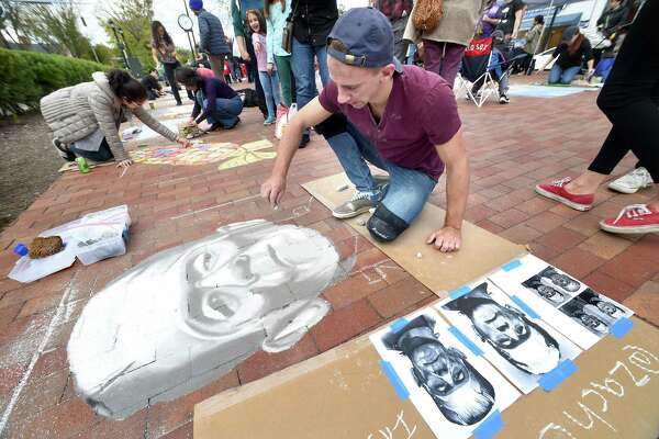 Zachary Chernak of Naugatuck draws Frankenstein during the New Haven Chalk Art Festival on the Broadway Island in New Haven on October 20, 2018. Chernak is an art teacher at Cooperative Arts & Humanities High School in New Haven.