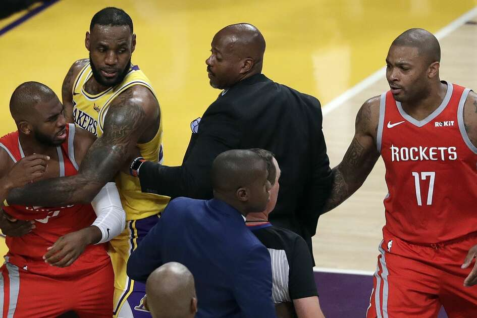 Houston Rockets' Chris Paul, left, is held back by Los Angeles Lakers' LeBron James, second from left, after Paul's fight with Lakers' Rajon Rondo during the second half of an NBA basketball game Saturday, Oct. 20, 2018, in Los Angeles. (AP Photo/Marcio Jose Sanchez)