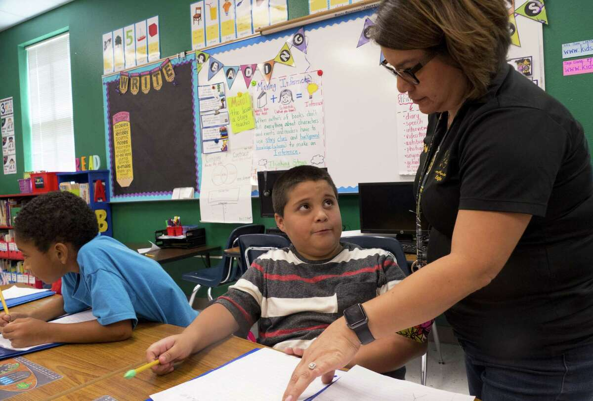 Teacher Peggy Trejo works with second-grade student Isacc Rodriguez at Collier Elementary on Oct. 12, 2018. Collier is in the Harlandale Independent School District.