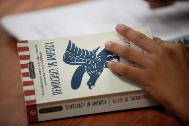 """Students in teacher Robert Funes' ninth-grade Humane Letters class study the book """"Democracy in America"""" by Alexis DeTocqueville using the open-ended Socratic method."""