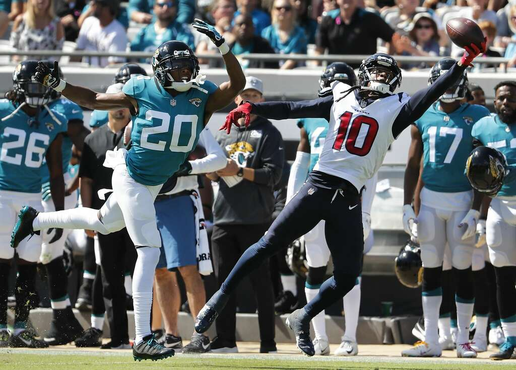 Houston Texans wide receiver DeAndre Hopkins (10) beats Jacksonville Jaguars cornerback Jalen Ramsey (20) with q one-handed catch for a first down during the first quarter of an NFL football game at TIAA Bank Field on Sunday, Oct. 21, 2018, in Jacksonville. Photo: Brett Coomer/Staff Photographer
