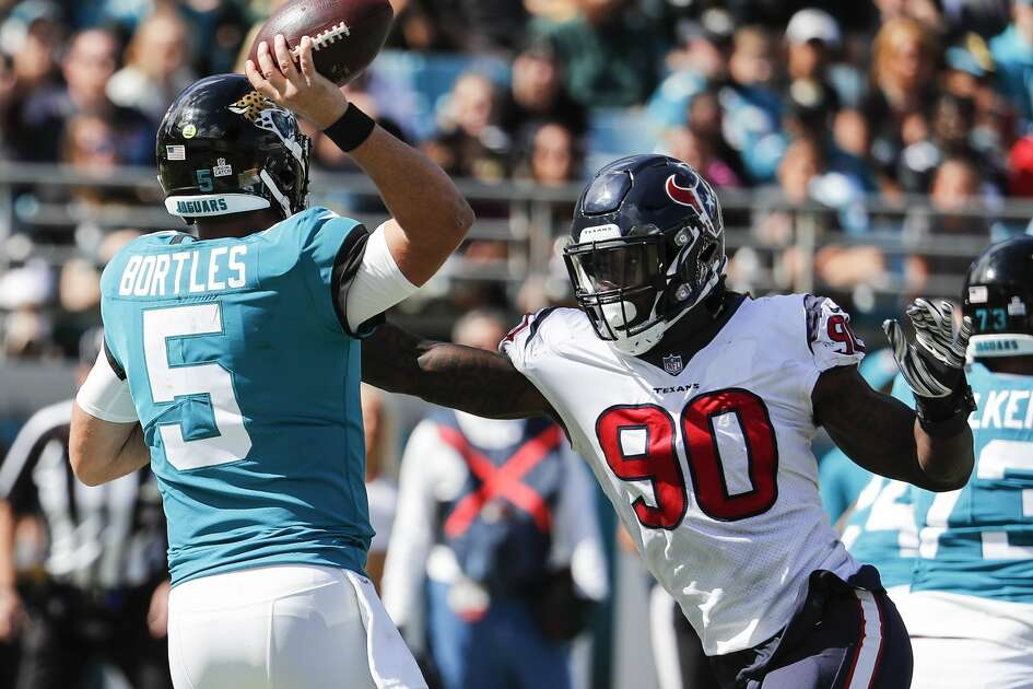 Houston Texans linebacker Jadeveon Clowney (90) pressures Jacksonville Jaguars quarterback Blake Bortles (5) into throwing an incomplete pass during the second quarter of an NFL football game at TIAA Bank Field on Sunday, Oct. 21, 2018, in Jacksonville.