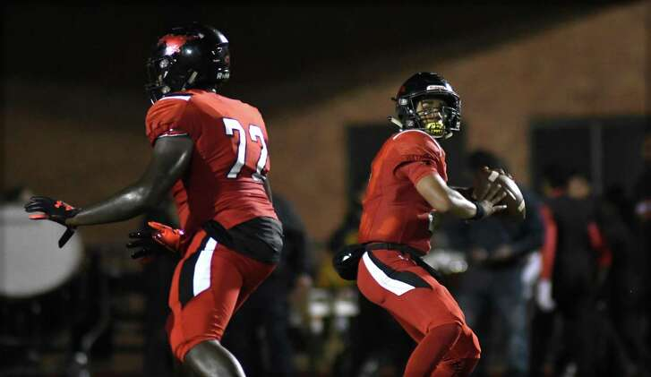 Westfield senior quarterback Ra'Quon Washington, right, targets a Mustangs receiver with protection from senior offensive lineman Cedric Claiborne (72) during the 2nd quarter of their district matchup at Leonard George Stadium in Spring on Oct. 12, 2018.