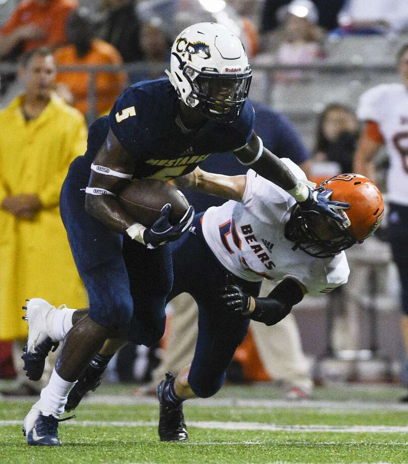 Cy-Ranch running back Willie Eldridge, left, pushes off Bridgeland defensive back Conner Gower during the first half of a high school football game, Friday, Sept. 21, 2018, in Cypress, TX. (Eric Christian Smith/Contributor) Photo: Eric Christian Smith, Contributor / Contributor