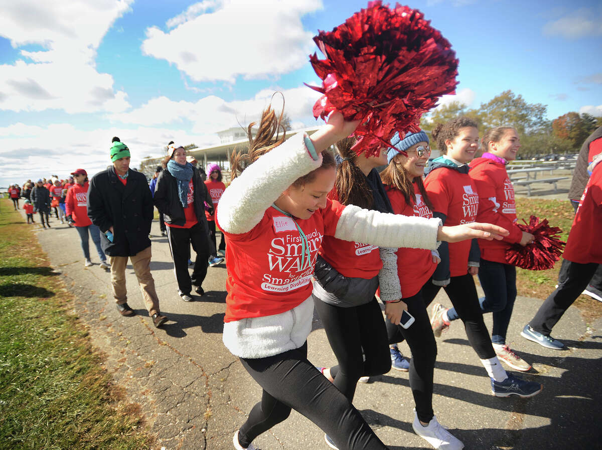 Ellie Bloss, left, of Wilton, and her friends gets in the spirit during the First Annual Smart Walk for Smart Kids at Sherwood Island State Park in Westport, Conn. on Sunday, October 21, 2018. The organization Smart Kids with Learning Disabilities' mission is to educate, guide, and inspire parents of children with learning disabilities and ADHD.