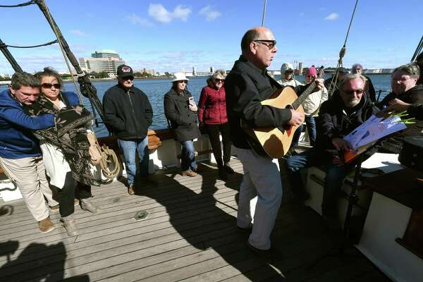 Laurence Capezzone performs during the North Branford Congregational Church's worship service aboard the Amistad in New Haven on October 21, 2018. Following the rebellion of enslaved Africans aboard the Amistad in 1839, Connecticut Congregationalists formed the Amistad Committee which was responsible for organizing a legal defense team for the enslaved Africans and later funding their return to Africa after a favorable Supreme Court ruling.