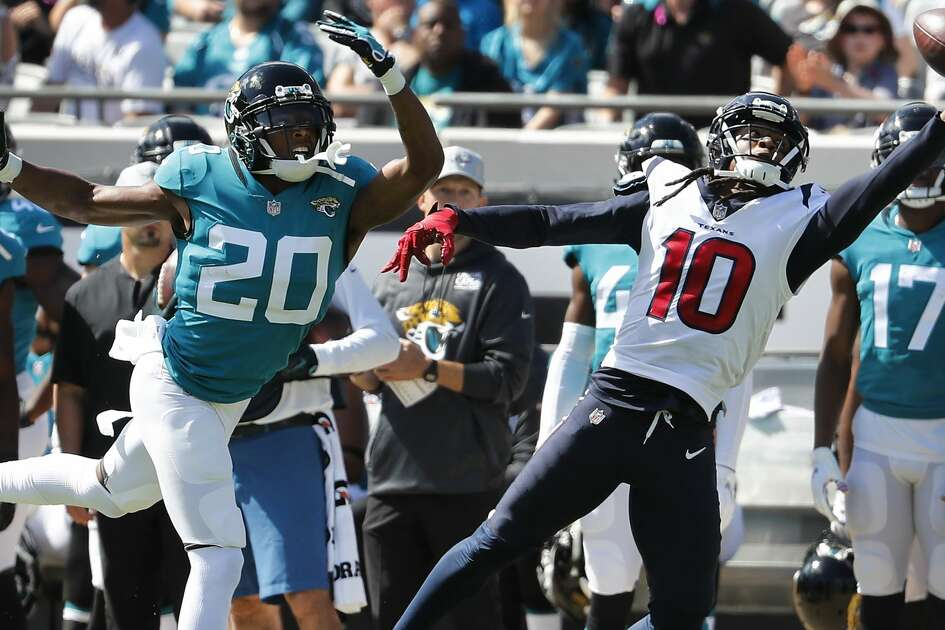 Houston Texans wide receiver DeAndre Hopkins (10) beats Jacksonville Jaguars cornerback Jalen Ramsey (20) with q one-handed catch for a first down during the first quarter of an NFL football game at TIAA Bank Field on Sunday, Oct. 21, 2018, in Jacksonville.