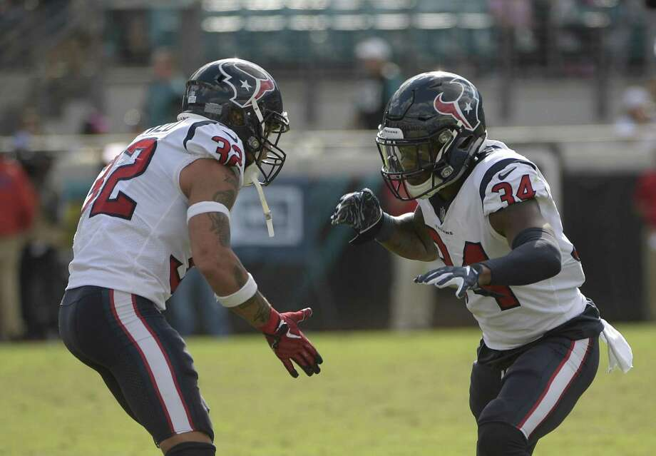 Houston Texans defensive back Mike Tyson (34) and free safety Tyrann Mathieu (32) celebrate a play against the Jacksonville Jaguars during the second half of an NFL football game, Sunday, Oct. 21, 2018, in Jacksonville, Fla. (AP Photo/Phelan M. Ebenhack) Photo: Phelan M. Ebenhack, FRE / Associated Press / Copyright 2018 The Associated Press. All rights reserved