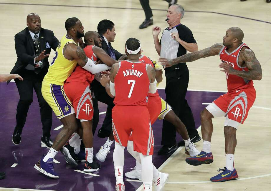 Houston Rockets' Chris Paul, second from left, is held back by Los Angeles Lakers' LeBron James, left, as Paul fights with Lakers' Rajon Rondo, center obscured, during the second half of an NBA basketball game Saturday, Oct. 20, 2018, in Los Angeles. The Rockets won, 124-115. (AP Photo/Marcio Jose Sanchez) Photo: Marcio Jose Sanchez, STF / Associated Press / Copyright 2018 The Associated Press. All rights reserved.
